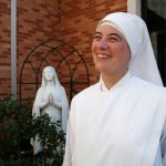 Sister Marie on the grounds Oct. 21, 2009, with a statue of the Virgin Mary in the background.  Sister Marie Sophie, a nun at Little Sisters of the Poor, just took a group to Rome for the canonization of the order's founder, Jeanne Jugan.  (Press-Register, Mary Hattler) religion, Sister Marie Sophie
