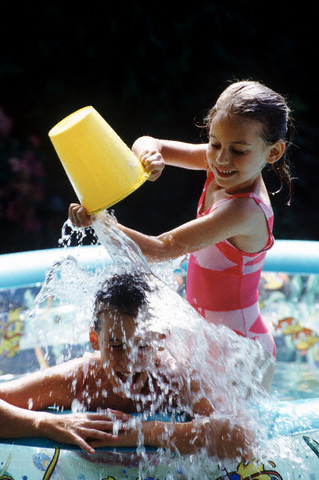 30 Nov 2001 --- Brother and sister in the pool --- Image by © Ed Bock/CORBIS